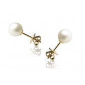 Gold earrings with large white pearls