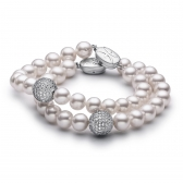 Two freshwater white pearl bracelets with jewellery balls