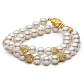 Two freshwater pearl bracelets with jewellery balls