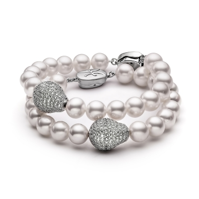 Two freshwater white pearl bracelets . Код 2222